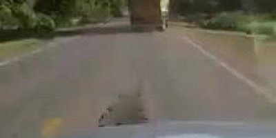 Motorista de caminhão imprudente dirigindo em zig-zag, colocando vidas em risco!