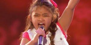 Menina surpreende jurados com a sua linda voz, ela escolheu Girl on Fire!