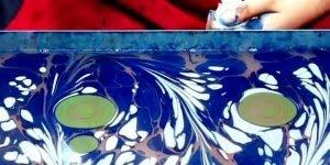A arte de pintar sobre a água, olha só que trabalho incrivel!!!