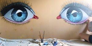 Desenhos de lhos feitos em uma parede, simplesmente lindíssimos!!!