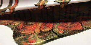 Obra de arte feita com tinta e escorredor de arroz, será que vai dar certo?