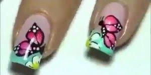 Unha decorada com lindo desenho de flor e borboleta, vale a pena conferir!!!